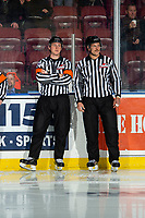 KELOWNA, BC - NOVEMBER 6: Referee Brett Iverson and lineman Dustin Minty stand on the ice at the start of the game between the Kelowna Rockets and the Victoria Royals at Prospera Place on November 6, 2019 in Kelowna, Canada. (Photo by Marissa Baecker/Shoot the Breeze)