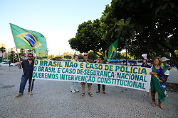 July 28, 2017 - Rio De Janeiro, Brazil - After levels of violence reach alarming levels, the Federal Government of Brazil authorizes military intervention in the State of Rio de Janeiro. Initially, more than 10,000 military personnel were made available to assist in the patrolling of the city of Rio de Janeiro and metropolitan cities. The decree of President Michel Temer was made after requests from the government of the State of Rio de Janeiro. In this image, demonstrators support the use of the armed forces in front of the General Headquarters of the Brazilian Army. (Credit Image: © Luiz Souza/NurPhoto via ZUMA Press)