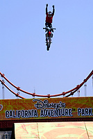 Jul 01, 2003; Anaheim, California, USA; Moto X star athlete MIKE METZGER executing a tremendous stunt hands free with a full sized motobike over the Park's replica of the Golden Gate Bride for the opening of Disney's California Adventure &quot;X Games Experience&quot;.  Disney park has built two X-Arena's specifically for this 41 day event highlighting extreme sports for the launch of the 2003 ESPN X Games.<br />
