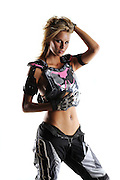 Beautiful sexy blond female in motocross riding gear on white background.  No logos, model released.