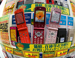 Many mobile phones for sale in a Tokyo shop