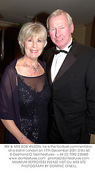 MR & MRS BOB WILSON, he is the football commentator, at a ball in London on 17th December 2001.OWJ 60