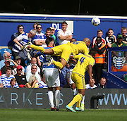 Kelvin Wilson (Nottingham Forest defender) getting fouled in an uneventful first half during the Sky Bet Championship match between Queens Park Rangers and Nottingham Forest at the Loftus Road Stadium, London, England on 12 September 2015. Photo by Matthew Redman.