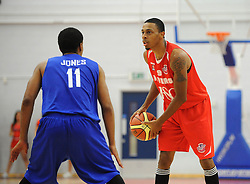 Bristol Flyers' Doug Herring comes up against Durham Wildcats' Christopher Jones - Photo mandatory by-line: Dougie Allward/JMP - Mobile: 07966 386802 - 18/10/2014 - SPORT - Basketball - Bristol - SGS Wise Campus - Bristol Flyers v Durham Wildcats - British Basketball League