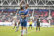 Wigan Athletic Forward, Will Grigg open the scoring and celebrates in front of the away fans during the Sky Bet League 1 match between Wigan Athletic and Bury at the DW Stadium, Wigan, England on 27 February 2016. Photo by Mark Pollitt.