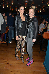 Left to right, AMANDA FERRY and ASTRID HARBORD at the opening party of MODE nightclub, 12 Acklam Road, London on 4th April 2014.