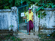 19 NOVEMBER 2017 - HWAMBI, YANGON REGION, MYANMAR: A man walks into the compound of Sacred Heart's Catholic Church in Hwambi, about 90 minutes north of Yangon, before mass. Catholics in Myanmar are preparing for the visit of Pope Francis. He is coming to the Buddhist majority country November 27-30. There about 500,000 Catholics in Myanmar, about 1% of the population. Catholicism was originally brought to what is now Myanmar more than 500 years ago by Portuguese missionaries and traders.    PHOTO BY JACK KURTZ