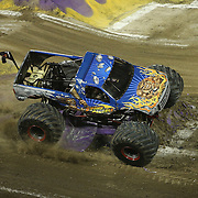 Stone Crusher driven by Steve Sims is seen during the Monster Jam big truck event at the Citrus Bowl in Orlando, Florida on Saturday, January 25, 2014. (AP Photo/Alex Menendez)