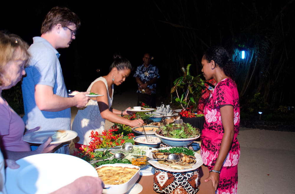 Guests Enjoying Traditional Fijian Dinner Beachside, Turtle Island, Yasawa Islands, Fiji