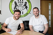 James Montgomery signs pictured with FGR's head of recruitment Richard Hughes signing for Forest Green Rovers at the New Lawn, Forest Green, United Kingdom on 23 May 2018. Picture by Shane Healey.
