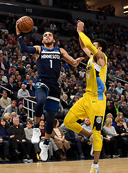 December 27, 2017 - Minneapolis, MN, USA - The Minnesota Timberwolves' Tyus Jones (1) scores a layup against the Denver Nuggets' Jamal Murray in the second quarter on Wednesday, Dec. 27, 2017, at Target Center in Minneapolis. (Credit Image: © Aaron Lavinsky/TNS via ZUMA Wire)