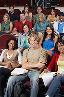Group portrait of college students in classroom