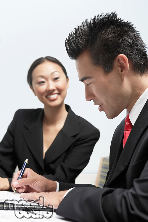 Businessman and Businesswoman in Meeting