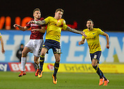 Northampton Town Midfielder Lawson D'Ath and Oxford United Forward Chris Maguire during the Sky Bet League 2 match between Oxford United and Northampton Town at the Kassam Stadium, Oxford, England on 16 February 2016. Photo by Adam Rivers.