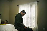 "BIRMINGHAM, AL – FEBRUARY 1, 2019:  Warren ""Azad"" Stoddard, 24, rests at his girlfriend's apartment one week after returning from Syria, where he was injured fighting ISIS as a volunteer alongside Kurdish YPG forces. CREDIT: Bob Miller for The New York Times<br /> <br /> In the war against ISIS, American volunteers have joined the ranks of a Syrian militia, operating independently of the United States. Until recently, the predominantly Kurdish YPG forces had enjoyed air and ground support from the United States, but now that US is officially leaving, the remaining American volunteers face uncertain odds. <br /> <br /> Warren Stoddard, 24, comes from a long line of military veterans and active service members. So when a knee injury prevented him from enlisting in the Marines in 2016, he reached out to a YPG liaison on Facebook to declare his interest in volunteering. ""I always wanted to serve, to do something worthwhile and to take part in some historical event,"" Stoddard said. ""And I cared about the Kurdish cause."" Two years later, as the Turkish invasion placed added pressure on the predominantly Kurdish YPG, Stoddard finally received an invitation to join and purchased his own one way ticket. Six months later, while engaging an ISIS stronghold alongside his YPG unit, Stoddard caught bullet fragments in his his upper thigh and foot, where a small fragment is still lodged."