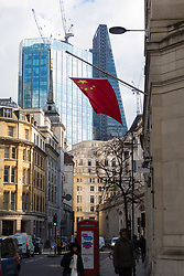 A Chinese flag blows in the breeze in the city's financial district as European markets follow US and Asian markets lower on Tuesday as investors continued to dump shares. London, February 06 2018.