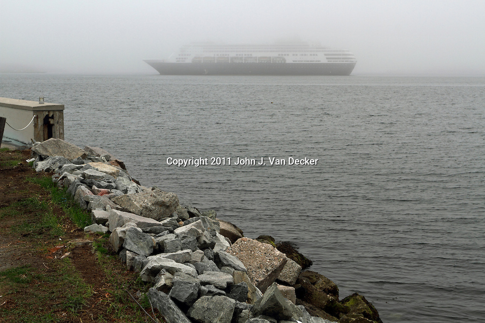 A Cruise Ship shrouded in fog in Narragansett Bay. Newport, Rhode Island, USA.