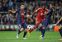 FUSSBALL  CHAMPIONS LEAGUE  HALBFINALE  RUECKSPIEL  2012/2013      FC Barcelona - FC Bayern Muenchen              01.05.2013 David Alaba (Mitte, FC Bayern Muenchen) gegen Cesc Fabregas (li) und Daniel Alves (re, Barca)