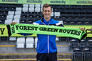 Forest Green Rovers Christian Doidge(9) signs a contract extension during the Forest Green Rovers Photocall at the New Lawn, Forest Green, United Kingdom on 31 July 2017. Photo by Shane Healey.
