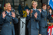 The Bluebird Belles perform period songs outside a hanger - Duxford Battle of Britain Air Show taking place during IWM (Imperial War Museum) Duxford's centenary year. Duxford's principle role as a Second World War fighter station is celebrated at the Battle of Britain Air Show by more than 40 historic aircraft taking to the skies.