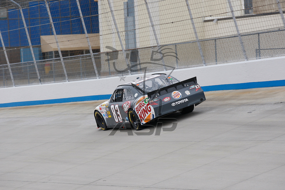 DOVER, DE - JUN 01, 2012:  Landon Cassill (83) brings his Burger King Toyota on the track for a practice session for the FedEx 400 Benefiting Autism Speaks at the Dover International Speedway in Dover, DE.