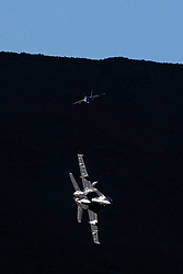 """US Navy Boeing F/A-18E Super Hornets NJ-255 and NJ-276 from Strike Fighter Squadron 122 (VFA-122) the """"Flying Eagles"""" fly into the Jedi Transition over Rainbow Valley, Death Valley National Park, California, United States of America"""