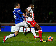 Picture by David Horn/Focus Images Ltd +44 7545 970036<br /> 25/01/2014<br /> Francois Zoko of Stevenage (centre) goes close early on and Phil Jagielka of Everton is unable to prevent the shot during the The FA Cup match at the Lamex Stadium, Stevenage.