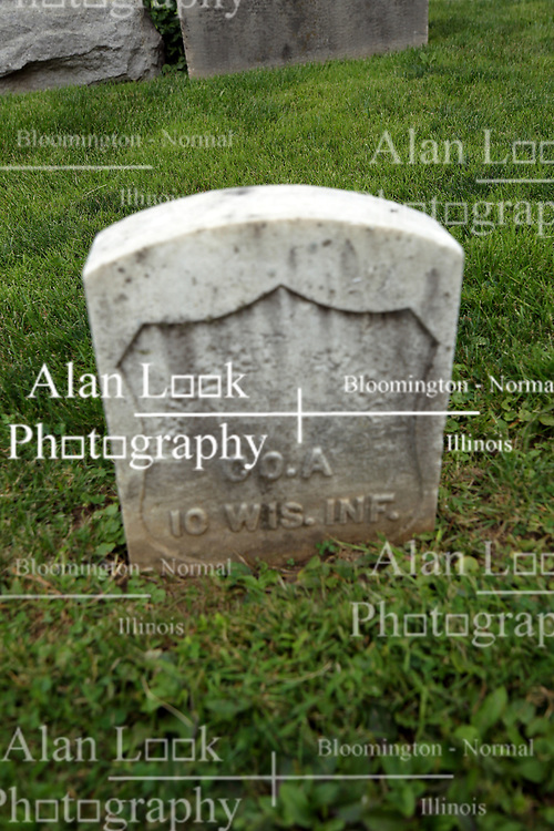 26 August 2017:   A part of the History of McLean County Illinois.<br /> <br /> Tombstones in Evergreen Memorial Cemetery.  Civic leaders, soldiers, and other prominent people are featured. Section 5, the old town soldiers area