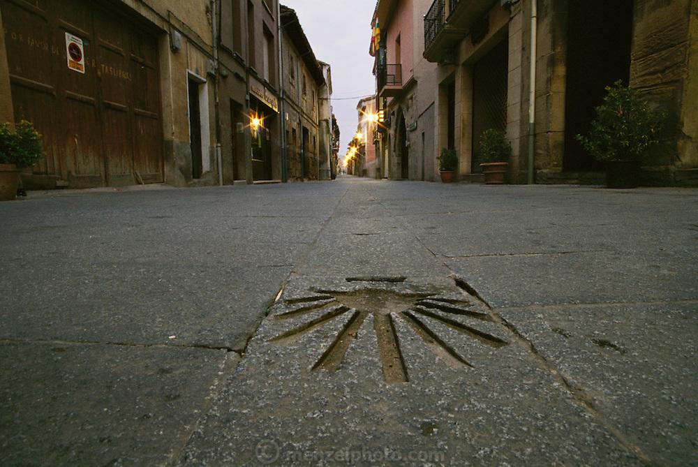 Sea shell design in the stone pavement of the Camino de Santiago, adjacent to the Parador Santo Domingo, Santo Domingo, Spain.
