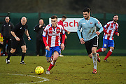 Dorking Wanderers James McShane controls the ball from Lewes FC Jack Dixon during the Ryman League - Div One South match between Dorking Wanderers and Lewes FC at Westhumble Playing Fields, Dorking, United Kingdom on 28 January 2017. Photo by Jon Bromley.