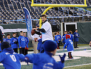Two-time championship MVP quarterback Eli Manning instructs children of Citi ThankYou cardmembers during an exclusive Citi youth football clinic in East Rutherford, NJ, Monday, November 4, 2013. (Photo by Diane Bondareff/Invision for Citi/AP Images)