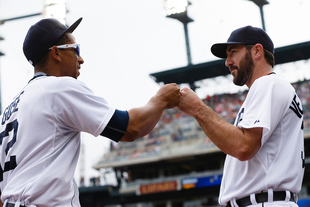 Jun 13, 2015; Detroit, MI, USA; Detroit Tigers center fielder Anthony Gose (12) receives congratulations from starting pitcher Justin Verlander (35) after making a diving catch of a ball hit by Cleveland Indians left fielder Michael Brantley (not pictured) in the first inning at Comerica Park. Mandatory Credit: Rick Osentoski-USA TODAY Sports