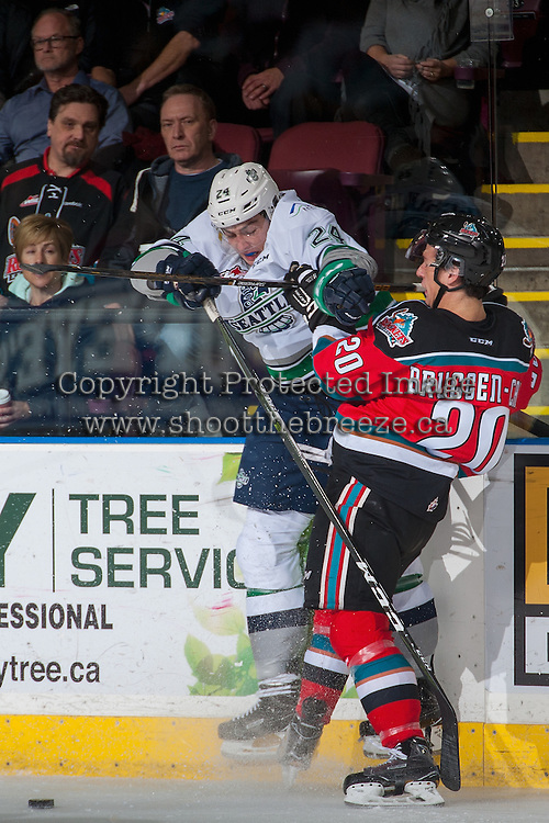 KELOWNA, CANADA - DECEMBER 7: Conner Bruggen-Cate #20 of the Kelowna Rockets checks Brandon Schuldhaus #24 of the Seattle Thunderbirds at the boards during first period on December 7, 2016 at Prospera Place in Kelowna, British Columbia, Canada.  (Photo by Marissa Baecker/Shoot the Breeze)  *** Local Caption ***