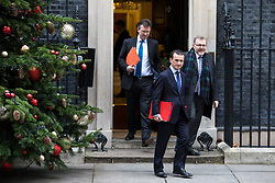 © Licensed to London News Pictures. 05/12/2017. London, UK. Attorney General Jeremy Wright (L), Secretary of State for Wales Alun Cairns (C) and Scotland Secretary David Mundell (R) leave 10 Downing Street after the weekly Cabinet meeting. Photo credit: Rob Pinney/LNP