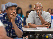 Houston ISD staff and NATEX architects discuss construction plans with community members during a meeting at Kashmere High School, September 15, 2015.