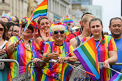 © Licensed to London News Pictures. 06/07/2019. London, UK. People dressed in rainbow coloured outfits lined along the route in support of the LGBT (Lesbian, Gay, Bisexual and Transgender/Transsexual) community as over 30,000 participants take part in the annual Pride Parade in central London. Photo credit: Dinendra Haria/LNP