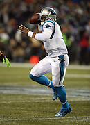 Carolina Panthers quarterback Cam Newton (1) rolls and throws a third quarter completed pass during the NFL week 19 NFC Divisional Playoff football game against the Seattle Seahawks on Saturday, Jan. 10, 2015 in Seattle. The Seahawks won the game 31-17. ©Paul Anthony Spinelli