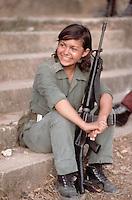 ca. March 1983, La Palma,El Salvador Portrait of a female guerrilla soldier in La Palma, El Salvador. --- Image by © Owen Franken/