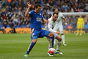 Leicester City forward Leonardo Ulloa  and Swansea City midfielder Leon Britton battle for the ball during the Barclays Premier League match between Leicester City and Swansea City at the King Power Stadium, Leicester, England on 24 April 2016. Photo by Alan Franklin.