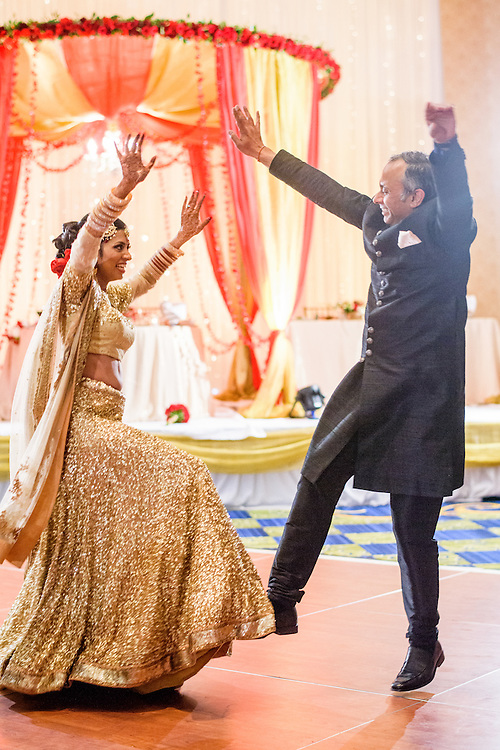 Baltimore, Maryland - December 20, 2014: Trisha Satya Pasricha her father Pankaj Pasricha perform a surprise Bollywood-influenced dance number during their Father-daughter dance. <br /> <br /> The couple, who met at Harvard, during a one of Trisha's student films, were married at the Baltimore Marriott Waterfront Hotel December 20, 2014. <br /> <br /> CREDIT: Matt Roth for The New York Times<br /> Assignment ID: 30168620A