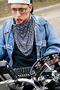 Physically challenged parade participant communicating with computer. MayDay Parade and Festival. Minneapolis Minnesota USA