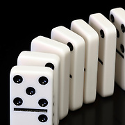 Dominoes ready to topple.