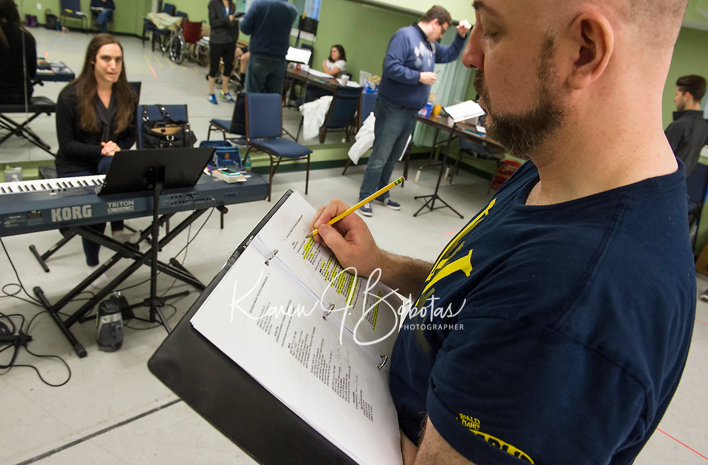 """Mark Stephen Woods makes adjustments to his script as rehearsal begin for the upcoming production of """"Rocky Horror Show"""" with the Winnipesaukee Playhouse.  (Karen Bobotas/for the Laconia Daily Sun)"""