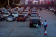 The car park fills up before the technical rehearsal of Puccini's La bohème is performed by members of  English National Opera (ENO) as a drive-in (ENO Drive and Live) at Alexandra Palace, on 18th September 2020, in London, England. This is Europe's first live drive-in opera production that audiences can safely experience from their cars and ENO's first public performance since the closure of their West End Colisseum home venue, because of the Coronavirus pandemic lockdown in March. As per the latest government advice. Each bubbled group consists of; 34 members of the<br /> ENO Orchestra, 20 ENO Chorus members and 8 principals. Each bubble has its own individual crew to oversee their rehearsals and performances.