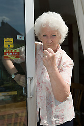 Older woman warning off burglars,