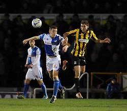 Bristol Rovers' Tom Lockyer challenges Southend United's Will Atkinson - Photo mandatory by-line: Dougie Allward/JMP - Mobile: 07966 386802 21/03/2014 - SPORT - FOOTBALL - Bristol - Memorial Stadium - Bristol Rovers v Southend United - Sky Bet League Two