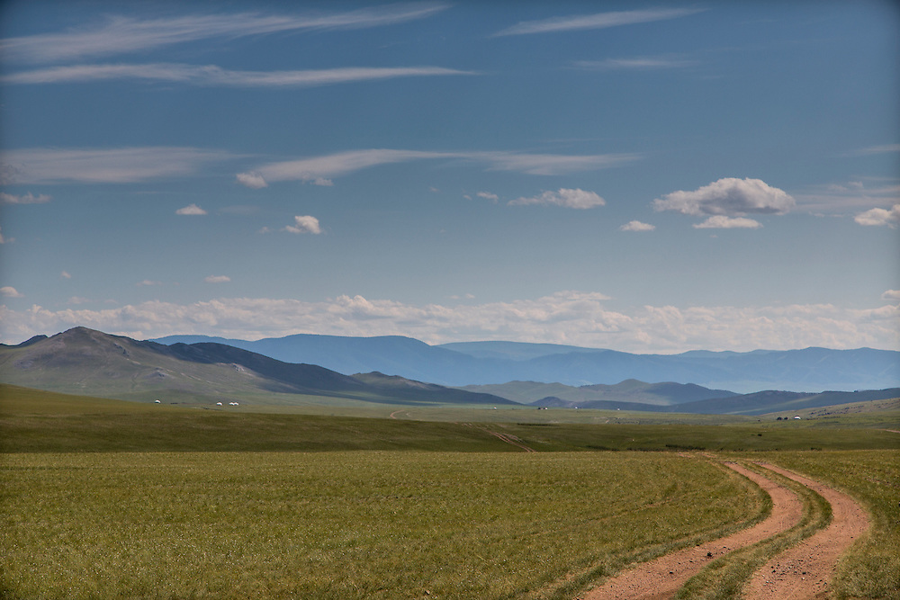 Dirt roads cross the landscape of the northern region of Mongolia near the city of Moron on July 23, 2012. © 2012 Tom Turner Photography.