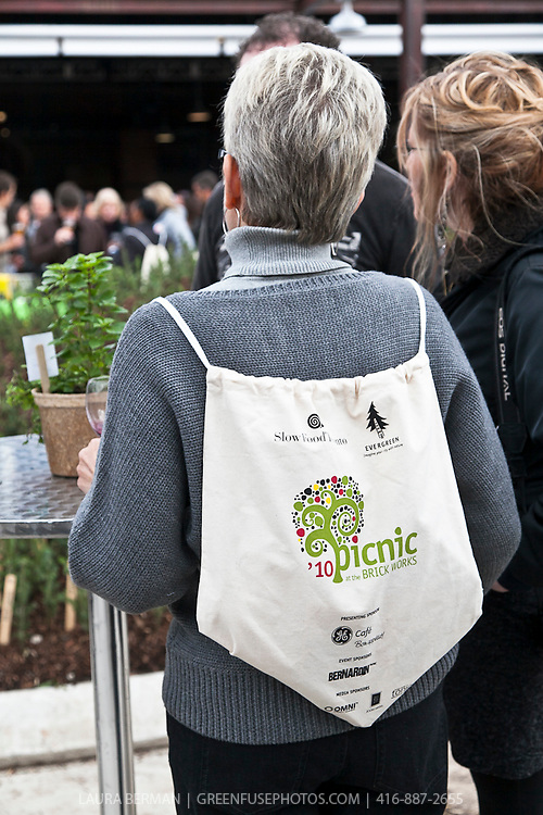 A woman wearing the gift knapsack at Slow Food's Picnic at the Brick Works in Toronto, 2010.