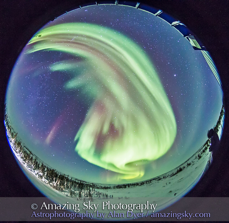 Auroral curtains are covering most of the sky from northeast to northwest, as seen Feb 13, 2015 from the deck of the Churchill Northern Studies Centre, Churchill, Manitoba. The fish-eye lens takes in almost the entire 360&deg; of the sky. <br /> <br /> This is a single exposure with the Canon 6D and Sigma 8mm fish-eye lens for 25 seconds at f/3.5 and ISO 4000.
