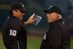June 28, 2011; Oakland, CA, USA;  MLB umpire Phil Cuzzi (10) explains the ground rules to Florida Marlins interim manager Jack McKeon (right) before the game against the Oakland Athletics at the O.co Coliseum.